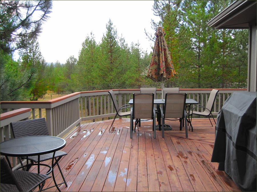 Sunriver rental large deck with gas barbecue grill, dining and lounge furnishings.