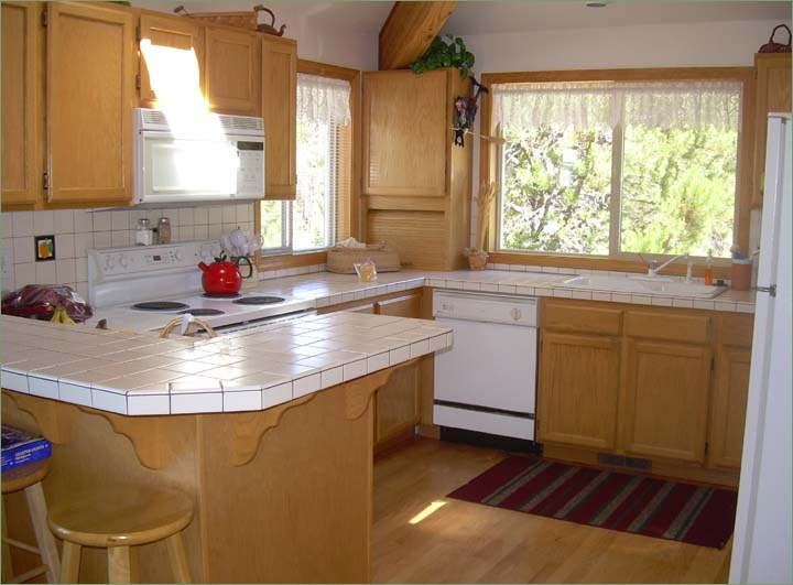 Large family kitchen fully equipped with modern appliances and cookware