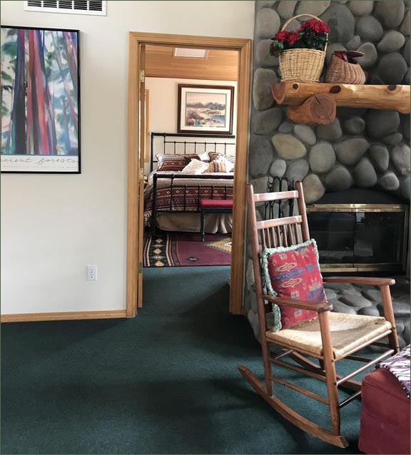 Private, upstairs master bedroom suite with direct access to the upper deck overlooking Sunriver's forested backyard.