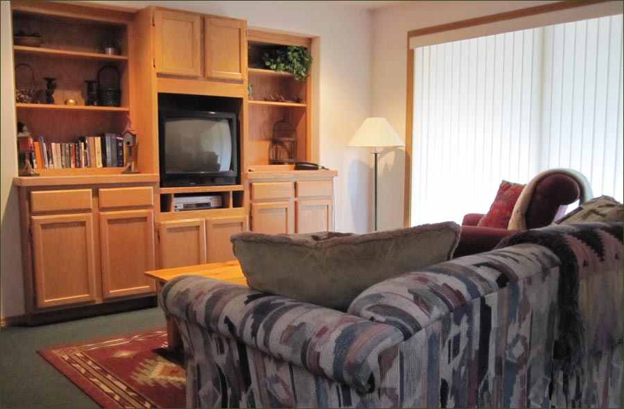 The family room is great for TV and kids. Here, you'll find a hide-away bed and the doorway leading to the deck with a large, bubbling HOT TUB...awaiting tired muscles!